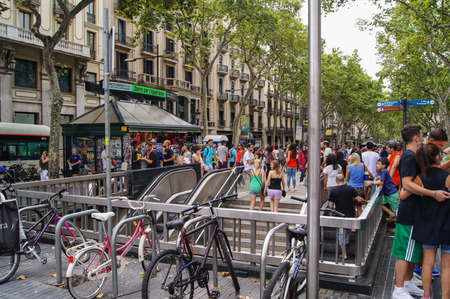 underground passage: Barcelona, Spain - August 1, 2015.Bicycles and a lot of people on the street with an underground passage.