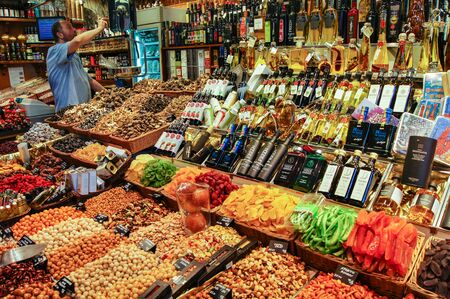 dried food: Barcelona market, Spain - August 1, 2015.Store nuts, dried fruit and vegetable oil. Editorial