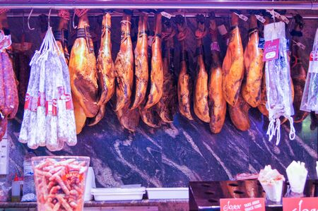 jamones: Barcelona market, Spain - August 1, 2015.Shop smoked sausages and hams.