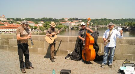 the quartet: Prague, Czech Republic - 12, June, 2015.The quartet of male street musicians playing the saxophone, kontrobase, oboe and guitar.