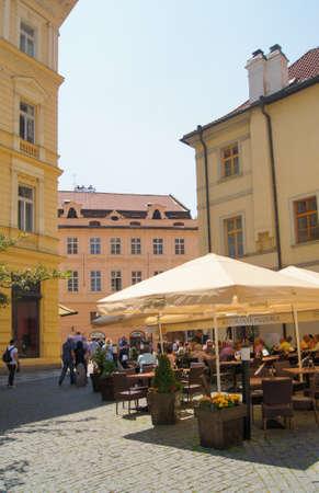 sun umbrellas: Prague, Czech Republic - 12, June, 2015.People sitting in a summer cafe under the sun umbrellas. Editorial
