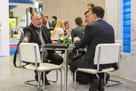 actively: St. Petersburg, Russia - 6 October, 2015.Expo forum. International Gas Forum. Three business that is actively discussing the table. Editorial