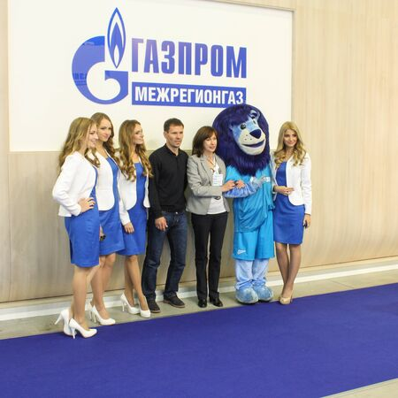 exhibition crowd: St. Petersburg, Russia - 8 October, 2015.Expo forum. International Gas Forum. Photos with girls representing the company. Editorial