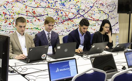 passionately: young people passionately working at a computer