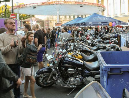 exhibition crowd: Several bikes among people. The annual summer bikers show in St. Petersburg Harley Davidson. Editorial