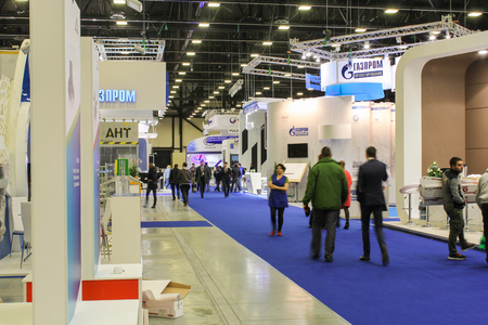 floor coverings: People passing on the blue floor coverings exhibition. St. Petersburg, Russia - 6 October, 2015.Expo forum. International Gas Forum.