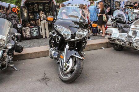 exhibition crowd: Parked at the curb motorcycles. St. Petersburg, Russia - 7 August, 2015. Bike Show Harley Davidson in St. Petersburg. Editorial