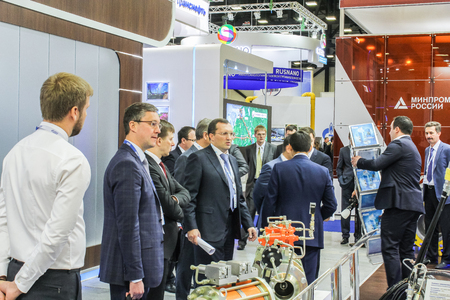 aggregates: Business people stand in front of aggregates. St. Petersburg, Russia - 6 October, 2015.Expo forum. International Gas Forum.