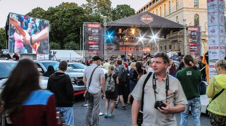 exhibition crowd: Crowd of people at a music venue. St. Petersburg, Russia - 7 August, 2015. Bike Show Harley Davidson in St. Petersburg. Editorial