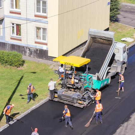asphalting: Asphalt roads in the yard. Leningrad region, Russia - 15 June, 2015. Landscaping and asphalting of yards.