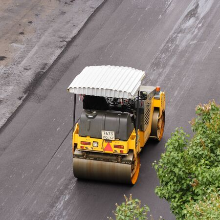 asphalting: Road vehicle for compacting asphalt. Leningrad region, Russia - 15 June, 2015. Landscaping and asphalting of yards.