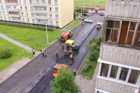 asphalting: Works on asphalting in the yard areas. Leningrad region, Russia - 15 June, 2015. Landscaping and asphalting of yards. Editorial