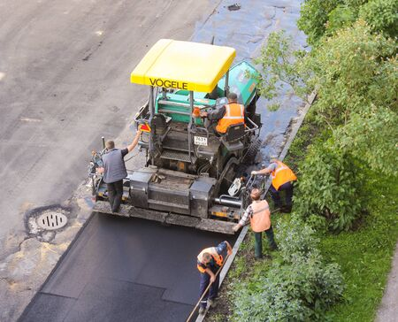 asphalting: Asphalt machine. Leningrad region, Russia - 15 June, 2015. Landscaping and asphalting of yards. Editorial