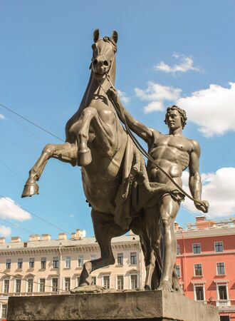 tourist spots: Sculpture of man and horse on the Anichkov Bridge. St. Petersburg, Russia - 6 September, 2015. Excursion - tourist spots in St. Petersburg.