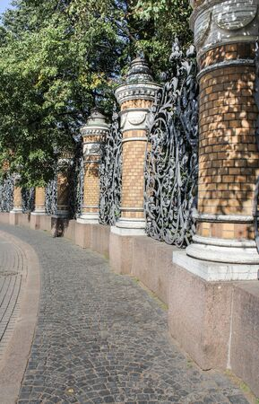 tourist spots: Fence of the Mikhailovsky Garden. St. Petersburg, Russia - 6 September, 2015. Excursion - tourist spots in St. Petersburg. Editorial