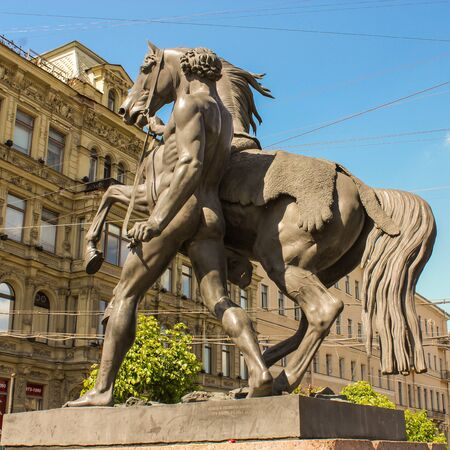 tourist spots: Sculpture of a man next to a horse St. Petersburg, Russia - 6 September, 2015. Excursion - tourist spots in St. Petersburg.