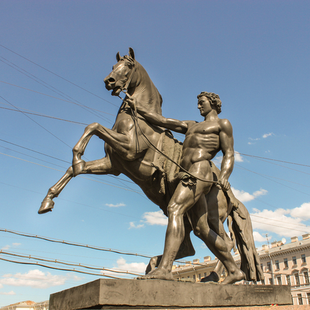 tourist spots: Sculpture of a man with a horse next to Anichkov Bridge. St. Petersburg, Russia - 6 September, 2015. Excursion - tourist spots in St. Petersburg.