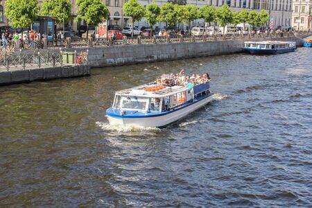 tourist spots: Tourists on a pleasure boat. St. Petersburg, Russia - 6 September, 2015. Excursion - tourist spots in St. Petersburg.