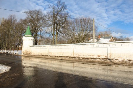 ladoga: Monastery walls with a turret along the road. Staraya Ladoga, Russia - 23 February, 2016. Tourist places in the great ancient route from the Vikings to the Greeks.Staroladozhsky Holy Assumption nunnery. Gold ring of Russia.