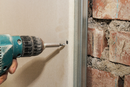 drywall: Twisted in drywall screw. Stock Photo