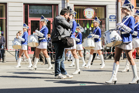 nevsky prospect: Photographer between the drummer girls. Day festive demonstration on the Nevsky Prospect in St. Petersburg, the first of May.