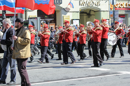 brass  band: Brass band on May Day. Day festive demonstration on the Nevsky Prospect in St. Petersburg, the first of May.