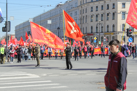 nevsky prospect: People with red banners of Lenin Komsomol. Day festive demonstration on the Nevsky Prospect in St. Petersburg, the first of May.