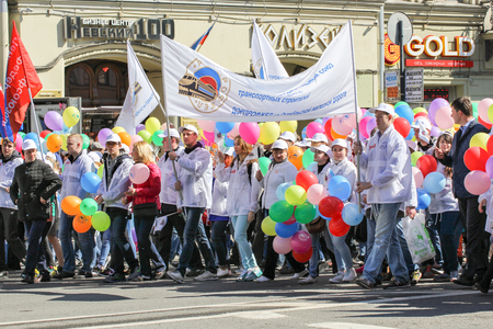 nevsky prospect: People with bundles of colorful balloons. Day festive demonstration on the Nevsky Prospect in St. Petersburg, the first of May. Editorial