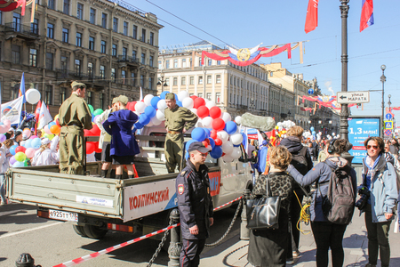 bodywork: People in military uniform in the bodywork. Day festive demonstration on the Nevsky Prospect in St. Petersburg, the first of May.