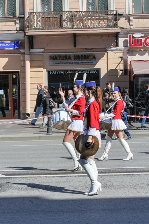 nevsky prospect: Young girls with percussion instruments on the street. Day festive demonstration on the Nevsky Prospect in St. Petersburg, the first of May. Editorial