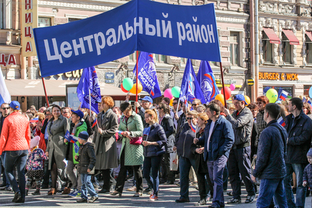 nevsky prospect: People under the banner of his district. Day festive demonstration on the Nevsky Prospect in St. Petersburg, the first of May.