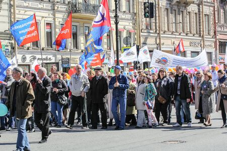 high day: The line of people with flags held high. Day festive demonstration on the Nevsky Prospect in St. Petersburg, the first of May.