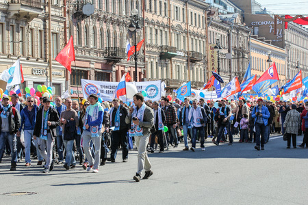nevsky prospect: Festive column of people on a city avenue. Day festive demonstration on the Nevsky Prospect in St. Petersburg, the first of May.