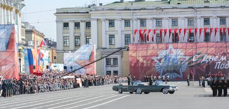 generals: The generals in open cars riding troops. Military Victory Parade at the Palace Square in St. Petersburg. Editorial
