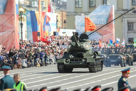 t34: T-34 tanks near the festive crowd. Military Victory Parade at the Palace Square in St. Petersburg.