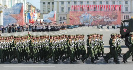 in the ranks: Slender ranks of soldiers on parade. Military Victory Parade at the Palace Square in St. Petersburg. Editorial