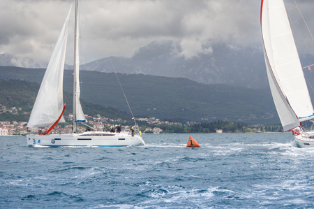 deployed: Yachts are deployed near the buoy. Sea race on yachts in the Bay of Kotor Adriatic Sea.
