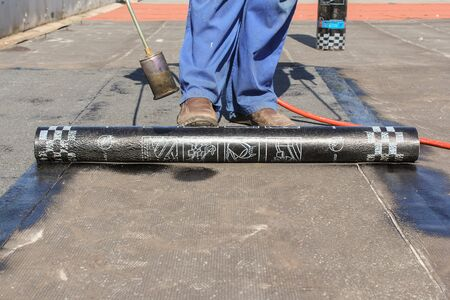 work material: Roofing Manufacturing with a burner. Roofing work using the deposited material and tools for this.