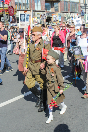 regiment: A couple of different ages. Holiday-action Immortal regiment taking place in St. Petersburg on Nevsky Prospect.