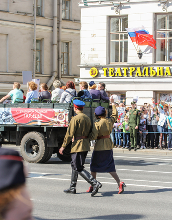 regiment: Couple in clothing of the war years. Holiday-action Immortal regiment taking place in St. Petersburg on Nevsky Prospect. Editorial