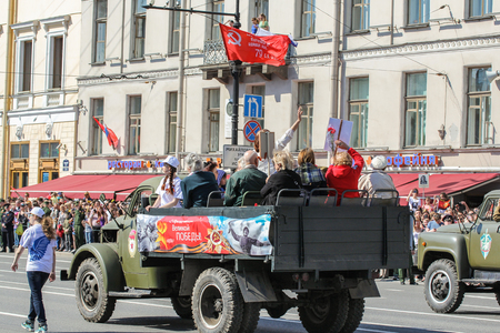 regiment: People passing in the back of a truck. Holiday-action Immortal regiment taking place in St. Petersburg on Nevsky Prospect.