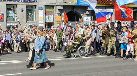 nevsky prospect: Veteran paratroopers in action Immortal regiment. Holiday-action Immortal regiment taking place in St. Petersburg on Nevsky Prospect.