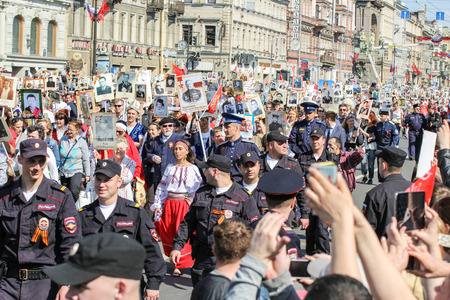 convoy: A crowd of people in the convoy. Holiday-action Immortal regiment taking place in St. Petersburg on Nevsky Prospect.