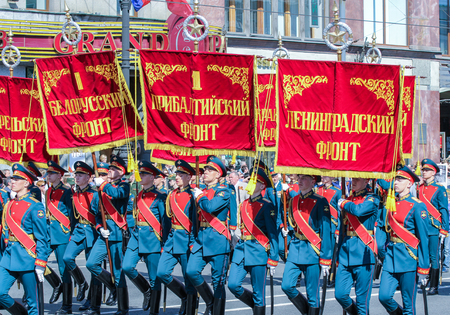 fronts: Soldiers with flags and banners of military fronts. Holiday-action Immortal regiment taking place in St. Petersburg on Nevsky Prospect.