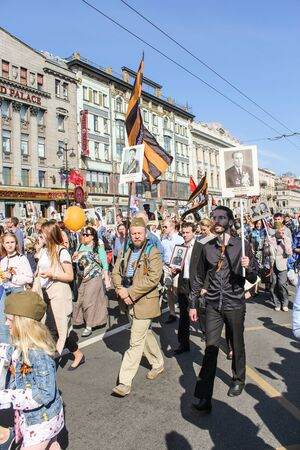regiment: People under St. Georges flags. Holiday-action Immortal regiment taking place in St. Petersburg on Nevsky Prospect. Editorial