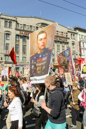 nevsky prospect: People with a portrait of Marshal Rokosovsky. Holiday-action Immortal regiment taking place in St. Petersburg on Nevsky Prospect.