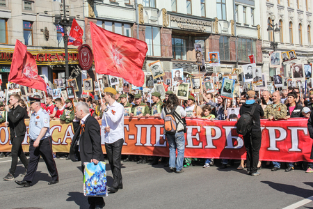 nevsky prospect: People behind a banner. Holiday-action Immortal regiment taking place in St. Petersburg on Nevsky Prospect. Editorial