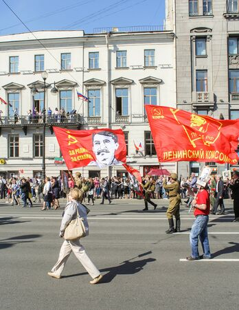 nevsky prospect: Large flag of the Soviet Union. Holiday-action Immortal regiment taking place in St. Petersburg on Nevsky Prospect. Editorial
