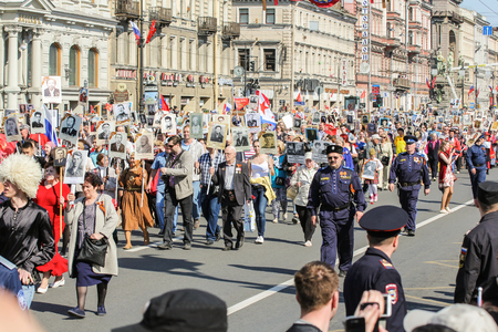 regiment: People in the column immortal regiment. Holiday-action Immortal regiment taking place in St. Petersburg on Nevsky Prospect.