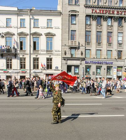 regiment: A teenager with a flag in his hand. Holiday-action Immortal regiment taking place in St. Petersburg on Nevsky Prospect. Editorial